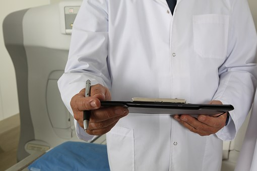 doctor online appointment doctor wearing coat and holding information